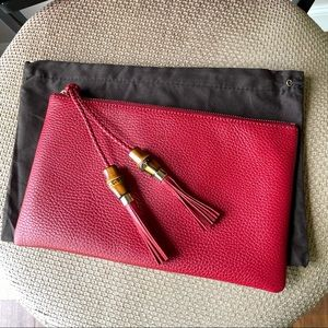 NWT Gucci leather pouch clutch with bamboo tassel